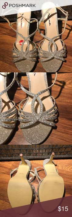 Size 6.5 small Heeled glitter shoes Size 6.5 glitter heels in excellent condition. Only worn once. Prices are always negotiable Touch of Nina Shoes Heels