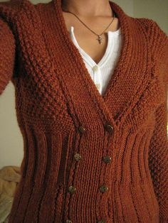 Ravelry pattern: V-Neck Cardigan. Double breasted, knit. $6.00