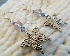 50% of the proceeds from these earrings go to an animal rescue group. Butterfly Charm Purple Tanzanite AB Swarovski by StephieGknits, $15.00