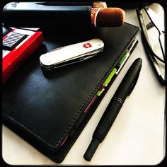 Got my kit for the long weekend ready: Filofax Nappa Personal Slim Pilot Capless LAMY sp1 (in the loop of the Filofax) Davidoff leather cigar case with a The Griffins and a Romeo y Julieta Churchills cigars Victorinox cigar-punch knife CoLibri cigar torch Skaga glasses #filofax #organiser #penknife #pocketknife #pocketknives #edc #lighter #colibri #Davidoff #TheGriffinscigars #griffincigars #romeoyjulieta #romeoyjulietacigars #churchills #robustos #cigars #pilotpen #pilotpens #PilotCapless…