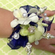 Flowers of Charlotte, Charlotte, NC custom Prom Corsages!  Bring out your inner Princess with Floral Jewelry to match your dress.  Find us at www.flowersofcharlotte.com