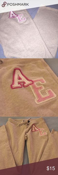 American Eagle size S sweat pants Cream with pink AE logo on left leg. Color quality great. No wear or tear. Pet and smoke free. American Eagle Outfitters Pants