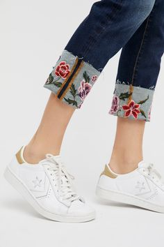 Collette Cigarette Jean | Cropped mid-rise jeans featuring a cuffed hem with beautiful floral embroidery.    * Cuffed hem slightly looser than calf and thigh   * Five-pocket design * Zipper closure
