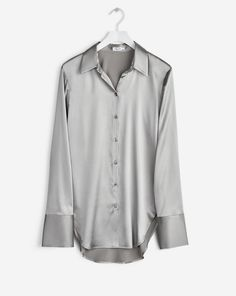 A tailored shirt in an luxurious and fluid stretch silk satin. Long sleeve cuffs. <br> <br> - Tailored fit <br> - Luxe silk satin <br> - Longer cuffs <br><br> The model is 181cm and wears size S.