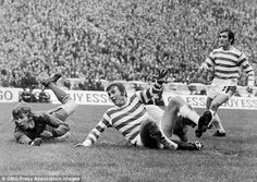 Alan Rough lies sprawled on the turf as Kenny Dalglish scores for Celtic with Lou Macari looking on.