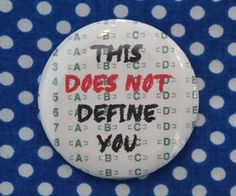 This does not define you 2.25 inch pinback button by PinMePaula