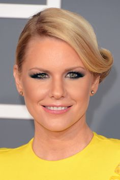 Carrie Keagan Retro Updo - Carrie Keagan's side swept retro updo was both glamorous and fun on the red carpet.