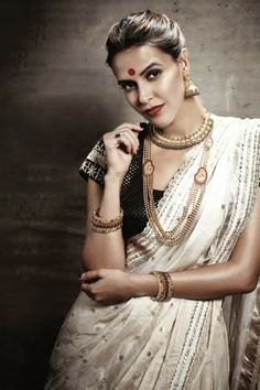 Neha Dhupia channeling a vintage bridal look. Love her saree, bindi and jewellery. Indian celeb fashion.