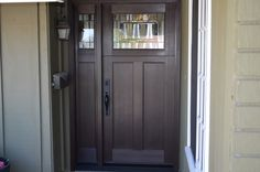 This is a Craftsman style door and if you look under the window you can see this is also a Dutch door.