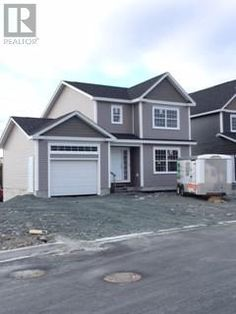 35 CHALLENGER Crescent Paradise Newfoundland (1122640) | Award Winning New Victorian Homes is constructing this modern design 2-storey home complete with dark siding, upgraded shingles and more. For more info contact Wally Lane (709) 764-3363 wally@normanlane.ca