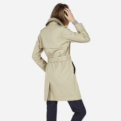The classic trench coat, complete with a belt that we think looks great tied  100% cotton Fabric is a premium water-resistant cotton canvas that's lightweight but still holds its structure Features luxuriously lined sleeves and a back vent Dry clean only