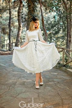 Pretty tea length wedding dress features floral lace patterns skirt and knee length lace sleeves, slim fitted silk satin bodice makes a contrast. Thin black ribbon is attached at natural waist, U back with zipper closure.