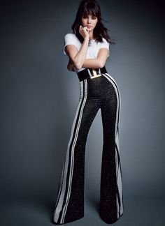 Dancing Queen - Who says disco is dead? A clean white tee and elongated stripes breathe modernity into glittering high-waisted flares and a retro-buckle belt. Theory cotton T-shirt. Balmain trousers and belt.