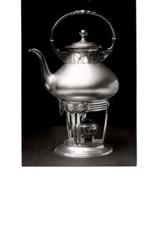 Gustav Gaudernack design for David Andersen. Coffeepot with heater and stand in silver with apple pattern. ca 1905