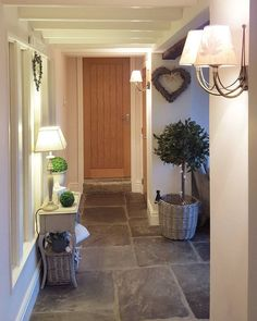 Stone flagged floor, wooden doors and white paintwork Style At Home, Cottage Hallway, Cottage Interiors, Stone Flooring, Home And Deco, Home Fashion, Home Renovation, My Dream Home, Ideal Home