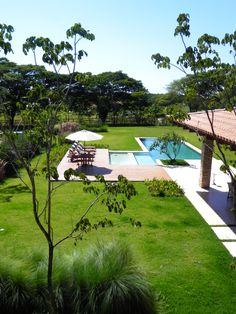 Catê Poli Paisagismo - Caterina Poli - Gardening Landscape Design Piscina Pool Haras Larissa Jardim Deck Ombrellone