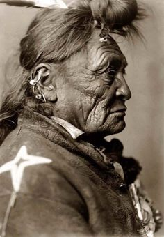 Here for your enjoyment is an exciting photograph of Hoop On Forehead, an Old Crow Indian. It was made in 1908 in Montana by famous photographer Edward S. Curtis.