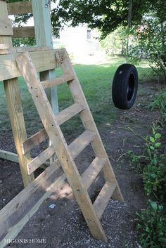 DIY Pallet playground for kids with reused materials like pallets and tire