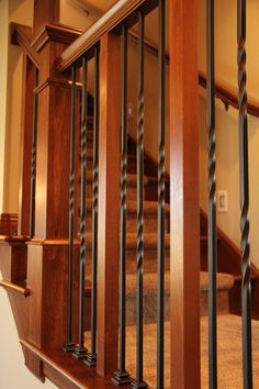 Stair Systems | Poplar staircase with twisted black forged iron balusters | Bayer Built Woodworks