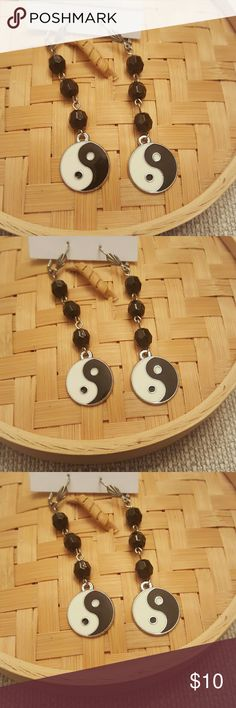 Ying yang dangle earrings Ying yang dangle earrings with black lucite charm connected beads.   2 inches in length light weight Jewelry Earrings