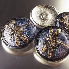Dragonfly buttons. People on Etsy make beautiful earrings with these Czech glass buttons.