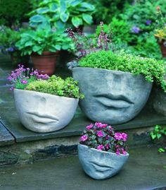 Saw these in a  landscape ad in a magazine.  They were on a pedestal in the ad...but I want them. Had to look them up.  Must have!  Faccia Planter - Large by Campania International