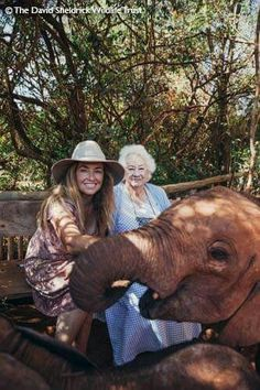 Young elephant with young blood long-hIred Safari lady & looks like a Grandma