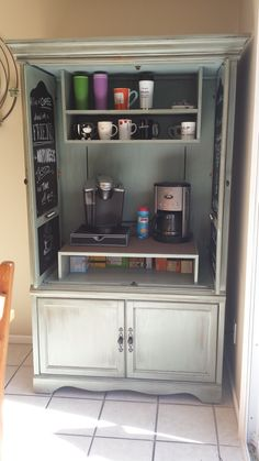 INSIDE PIC of my Oak armoire to coffee bar. Hubby made the upper shelves to match the bottom, doors are chalkboard inside with quotes about coffee. Chalk holders are repurposed scrabble tile holders, glued onto doors.