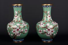 Description A pair of Chinese cloisonné enamel bottle vases Decorated on the cloud scroll turquoise ground with large sprays of lowering prunus.  Date 20th century   www.collectorstrade.de