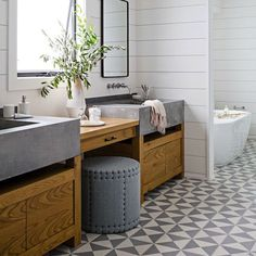 Shiplap-bathroom-design-wood-and-concrete-vanity-with-patterned-floors