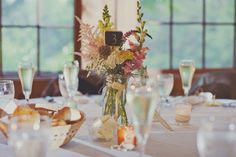 Pin for Later: 100 Ideas For a Summer Camp Wedding Wildflower Centerpieces Photo by Our Labor of Love via Style Me Pretty