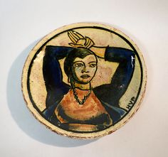 Plate  Designer:Henry Varnum Poor (American, Chapman, Kansas 1887–1970 New City, New York) Date:ca. 1922 Medium:Earthenware Dimensions:D. 8-1/4 in. (21 cm.) Classification:Ceramics-Pottery