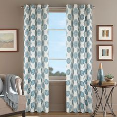 Brighten your room's décor with the chic Orion Morocco Grommet Top Window Curtain Panel. The beautiful panel features an allover round Moroccan tile print in aqua on a white ground to give your space a sophisticated look.