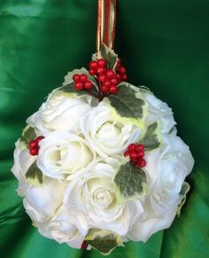 """Christmas White roses with a sprinklin of red and green holly adorned with red and gold ribbon make up """"Christmas Day"""" kissing ball. on Etsy, $36.00"""