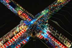 This viewpoint, taken from an apartment block above, shows the hustle and bustle of people doing their last minute shopping during the week before the local Lunar (Chinese) New Year. Chinatown, Singapore. Photo by Eddie Cheng