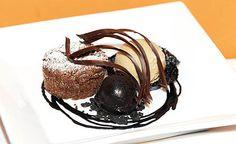 Hot Chocolate Cake with cocoa nib ice cream, dark chocolate sorbet, cocoa nib crisp and chocolate sauce.