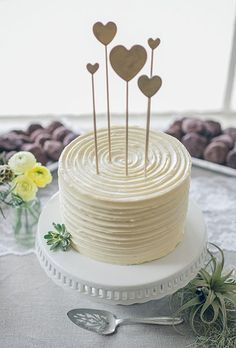 14 Minimalist White Wedding Cake Styles — the bohemian wedding // White Single Tier Wedding Cake with Hearts