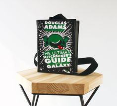 The Hitchhiker's Guide to the Galaxy Book Bag Black Leather Book Purse by KrukruStudioBooks on Etsy https://www.etsy.com/listing/526226443/the-hitchhikers-guide-to-the-galaxy-book