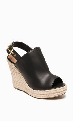 Classic casual wedge sandals made with faux leather. Braided jute covers the wedge and platform. So cute and will go with just about any casual outfit.