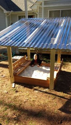 Son's sandbox with roof