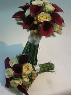 white roses and red calla lilies