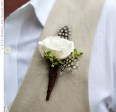 A Garden Wedding in Dallas, TX  For continuity, brown spotted feathers were incorporated into the guys' boutonnieres; Ty also wore a white majolica spray rose.