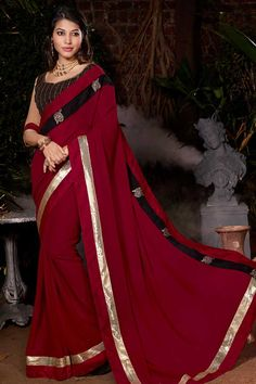 Maroon georgette saree with beige art silk blouse.  Embellished with stone and patch.  Saree comes with sweet heart neck blouse.  It is perfect for festival wear, party wear and wedding wear.  Andaaz Fashion is the most popular designer wear online ethnic shop brands.  http://www.andaazfashion.us/womens/sarees/view/new-arrival-saree