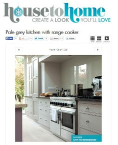 An elegant painted kitchen with a range cooker, glass splashback and custom made extractor - http://martinmoore.com - http://www.housetohome.co.uk/kitchen/picture/pale-grey-kitchen-with-range-cooker