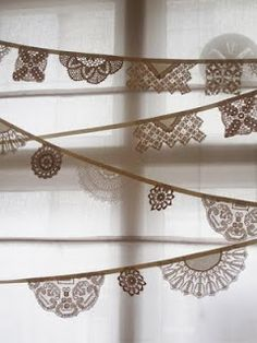 Beautiful way to use less than perfect doilies....a lace garland/banner!