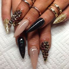 Stilleto Nails.