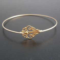 Thin Gold Bangle Bracelet, Fiona - Gold Vermeil Bracelet, Gold Vermeil Jewelry, Dainty Gold Bangle, Thin Gold Bangle, Dainty Gold Bracelet. $29.95, via Etsy.