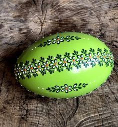 Hand painted Green color Ostrich egg. This egg is decorated with wax. The eggs are decorated using a wax pinhead and is the oldest and most widely used technique. The tradition of painted eggs back...
