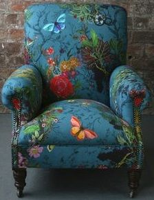 Great armchair covered in sumptious fabric. Timeless.
