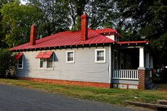 red roof. grey walls. white trim.